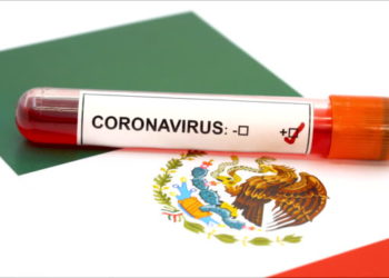 Blood sample positive with Coronavirus and Mexican Flag // 4K 3840x2160 / 29.97p / Photo-JPEG / Real Time /